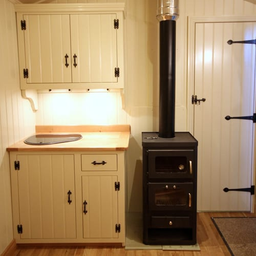 Wood stove with a baking oven in tiny house
